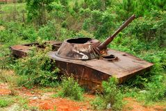 The remains of a bombed out Russian tank in northern Loas. The remains of a bombed out Russian tank used by the Viet Cong in Loas during the Vietnam War stock image
