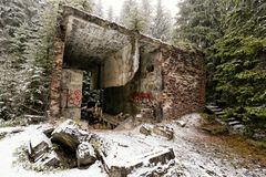 Remains of brick walls of the scary building in the woods. Devastated by vandals royalty free stock image