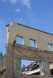 Remains broken shell of the building in Donetsk Stock Photos