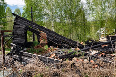 Remains of burned down house Stock Images