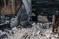 The remains of the burned house. Burnt walls stock photo