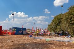 Remains of Cambodian amusement park after Cambodia beer event party. Garbage scatter around area. Plastic pollution in Cambodia Is one of the biggest in the royalty free stock photos