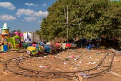 Remains of Cambodian amusement park after Cambodia beer event party. Garbage scatter around area. Plastic pollution in Cambodia Is one of the biggest in the royalty free stock image