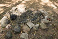 Remains of a campfire, canton, MA. Many conservation areas have areas in Massachusetts have areas for camping. This includes areas where campfires are permitted Royalty Free Stock Photography