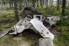 Remains of the car in forest Stock Images
