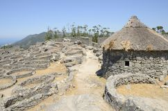 Remains of a celtic settlement. Prehistoric reconstructed house in the remains of a celtic settlement in Santa Tecla Mount   in Galicia, Spain Royalty Free Stock Images