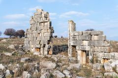 The remains of the central entrance on the ruins of the destroyed Roman temple, located in the fortified city on the territory of royalty free stock photo