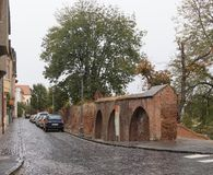 The remains of the city fortress wall on the Manejului street in a rainy day. Sibiu city in Romania Stock Photo