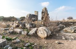 The remains of the columns on the ruins of the destroyed Roman temple, located in the fortified city on the territory of the Nafta royalty free stock photos