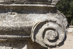 Remains of a Corinthian column in Olympia, Greece Stock Image
