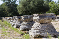 Remains of a Corinthian column in Olympia, Greece Royalty Free Stock Photo