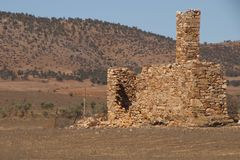 Remains of a derelict homestead in outback landscape royalty free stock photos