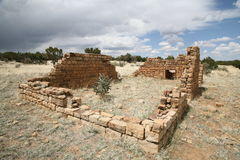 Remains of desert homestead. A view of the remains of what once was a homestead where a family tried to make a living in the harsh desert of New Mexico Stock Photo