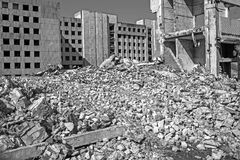 The remains of the destroyed building of a large industrial facility. Background. Black and white image.  royalty free stock images