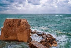 Remains of fortress walls of the Acre. And the Mediterranean Sea Stock Photo