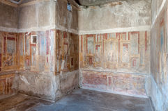Remains of frescos inside casa di apollo in Pompeii Italy. Pompe Royalty Free Stock Images