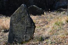 Remains of half broken tombstone on jewish cemetery next to castle Beckov, Slovakia Royalty Free Stock Image