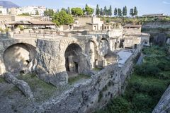 Remains of Herculaneum Parco Archeologico di Ercolano. Pictured are remains of Herculaneum in the Parco Archeologico di Ercolano. The archaeological excavations Stock Photos
