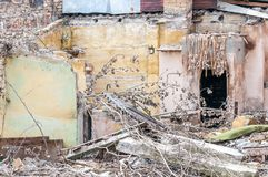 Remains of hurricane or earthquake disaster total damage on ruined old house or building.  Stock Images