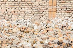 Remains of hurricane or earthquake disaster total damage on ruined old house or building.  Stock Photo
