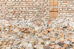 Remains of hurricane or earthquake disaster total damage on ruined old house or building with pile of bricks.  Royalty Free Stock Images