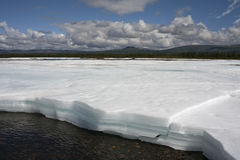Remains of the ice in the river valley after the winter. Royalty Free Stock Photography