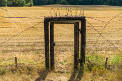 Remains of iron curtain with door inside wire fence Royalty Free Stock Image