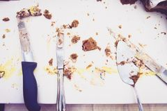 Remains and leftovers of cutting cake at wedding party. Stock Images