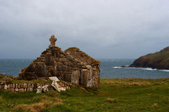 Cape Cornwall St. Helen's Oratory. The remains of the medieval chapel, St. Helen's Oratory, sit on the exposed cliffs of Cornwall's north coast at Cape Cornwall Stock Images