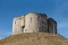 The remains of the midieval castle on the hill in the centre of. The preserved remains of the old midieval castle sitting on the only hill in the centre of York stock photography
