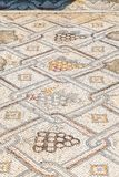 Remains of a mosaic on the floor in ruins of Kursi - a large Byzantine 8th-century monastery on the shores of Lake Tiberias, on th. E Golan Heights Royalty Free Stock Images