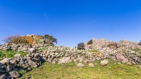 Menhir in Sardinia, Italy. Remains of nuraghe or fortress from the bronze age at Archeological site of Tamuli, Sardinia island, Italy royalty free stock photos