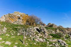 Menhir in Sardinia, Italy. Remains of nuraghe or fortress from the bronze age at Archeological site of Tamuli, Sardinia island, Italy royalty free stock photography