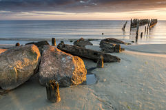 Remains of old broken pier, Baltic Sea, Latvia Stock Images