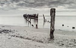 Remains of old broken pier, Baltic Sea, Latvia Royalty Free Stock Photo