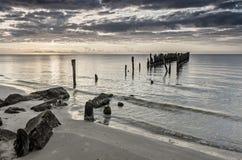 Remains of old broken pier, Baltic Sea, Latvia Stock Photos