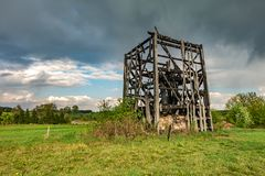 Remains of old burnt windmill in the field before the rain stock image
