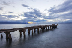 Remains of an old consrete pier at sunset Royalty Free Stock Image
