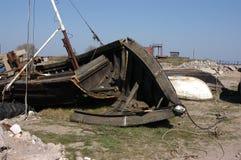 Remains of an old fishing boat seashore Royalty Free Stock Photos