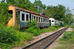 Remains of old railway carriages. And railway in Thailand Stock Images