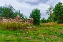 Remains of an old stone ruined village house stock image
