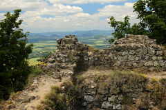Remains of the old stone walls on the hill Royalty Free Stock Photos
