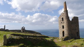 The remains of an old tin and copper mine on the cliffs of Cornwall UK Stock Photos