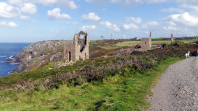 The remains of old tin and copper mines on the cliffs of Cornwall UK Stock Photography