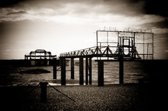 Remains of the old west pier. On cold and wet day on beach in Brighton, England, UK Stock Photos