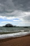 Remains of old west pier with stormclouds Stock Images