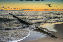 Remains of old wooden pier in Curonian Spit, Lithuania Stock Photo
