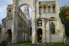 The remains of the portal and ruined walls of  medieval benedictine Jumieges Abbey stock images