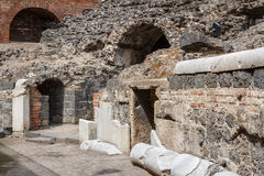 Remains of the Roman amphitheatre in the historic centre. Of Catania, Sicily island, Italy Stock Photo