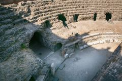 Remains of the Roman amphitheatre in the historic centre of Catania, Sicily island, Italy Royalty Free Stock Photography